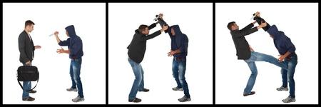 defensa personal: Hombre defenderse contra un ataque con arma blanca con un malet�n. Concepto de leg�tima defensa