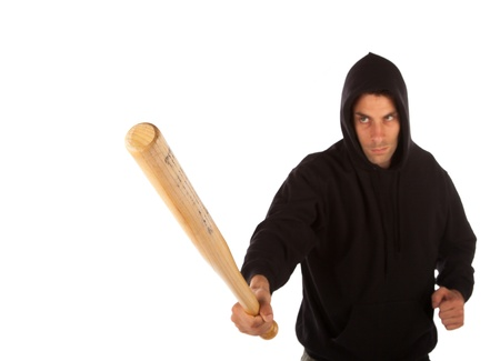 Hooligan with baseball bat isolated on white. Focus on bat Stock Photo - 21623035
