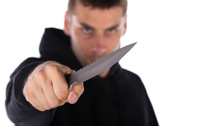 threatening: Man threatening with a large knife isolated on white Stock Photo