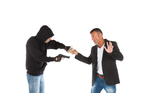 Robber with gun grabbing money from victim isolated on white background photo