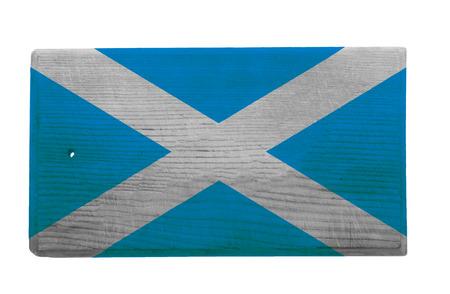 scottish flag: Old indossati e graffiato tagliere di legno con la bandiera scozzese su di esso Archivio Fotografico