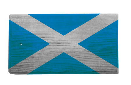 scottish flag: Old worn and scratched wooden cutting board with the Scottish flag on it Stock Photo