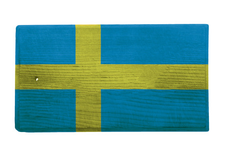 the swedish flag: Old worn and scratched wooden cutting board with the Swedish flag on it