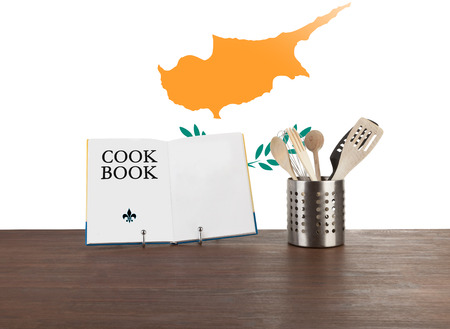 Cookbook and kitchen utensils with the Cypriot flag in the background Stock Photo - 23337714