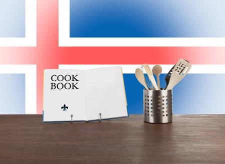 icelandic flag: Libro de cocina y utensilios de cocina con la bandera de Islandia en el fondo