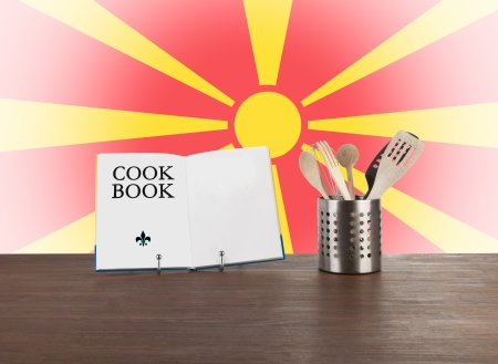 macedonian flag: Cookbook and kitchen utensils with the Macedonian flag in the background