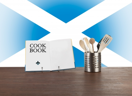 scottish flag: Cookbook and kitchen utensils with the Scottish flag in the background Stock Photo