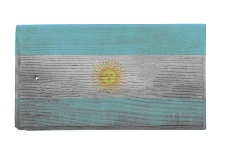 argentinian flag: Old worn and scratched wooden cutting board with the Argentinian flag on it Stock Photo