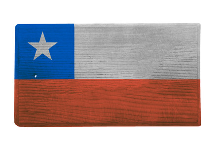 chilean flag: Old worn and scratched wooden cutting board with the Chilean flag on it