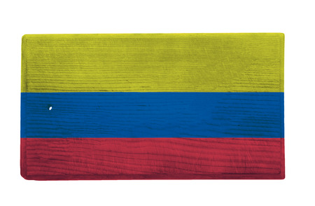 colombian flag: Old worn and scratched wooden cutting board with the Colombian flag on it