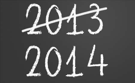2013 crossed and new year 2014 written on chalkboard photo