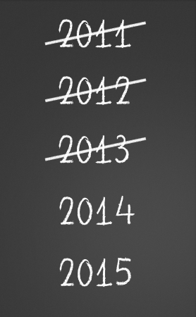 2011, 2012, 2013 crossed and new years 2014, 2015 on chalkboard photo