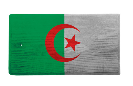 algerian flag: Old worn and scratched wooden cutting board with the Algerian flag on it