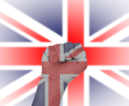 Fist wrapped in the flag of England and flag in the background photo