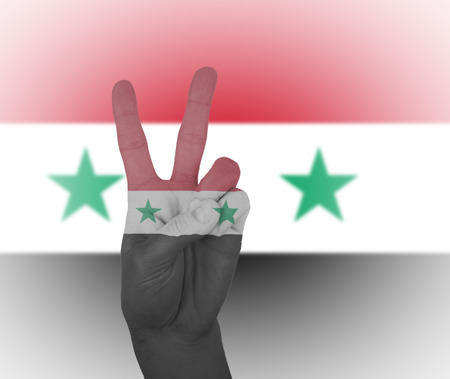 syria peace: Hand peace sign, wrapped in the flag of Syria