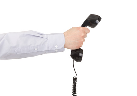 important phone call: Businessman hand with phone. concept for customer service or support line Stock Photo