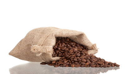 Coffee beans falling out burlap sack photo