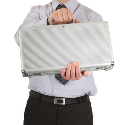 Businessman handing over a metal briefcase photo
