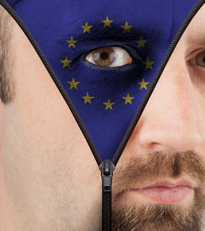 close-up of a face unzipping to show the flag of the European Union photo