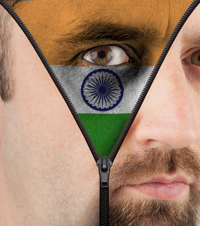 close-up of a face unzipping to show the flag of India photo
