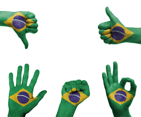 A set of hands with different gestures wrapped in the flag of Brazil photo