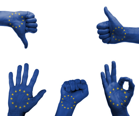 A set of hands with different gestures wrapped in the flag of the EU photo