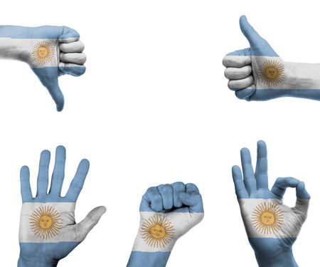 A set of hands with different gestures wrapped in the flag of Argentina photo