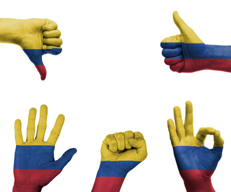 A set of hands with different gestures wrapped in the flag of Colombia photo