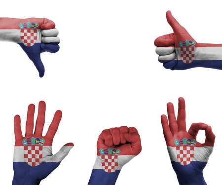 A set of hands with different gestures wrapped in the flag of Croatia photo
