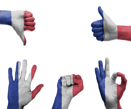A set of hands with different gestures wrapped in the flag of France photo