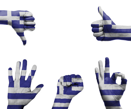 A set of hands with different gestures wrapped in the flag of Greece photo