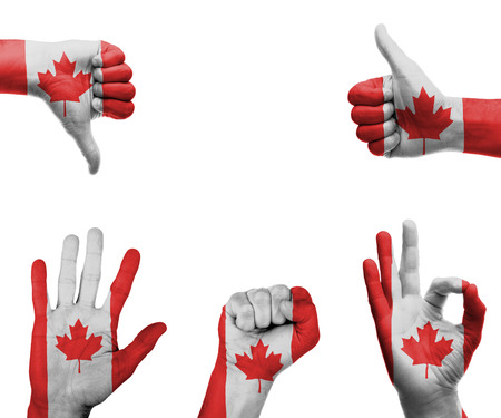 canada flag: A set of hands with different gestures wrapped in the flag of Canada Stock Photo