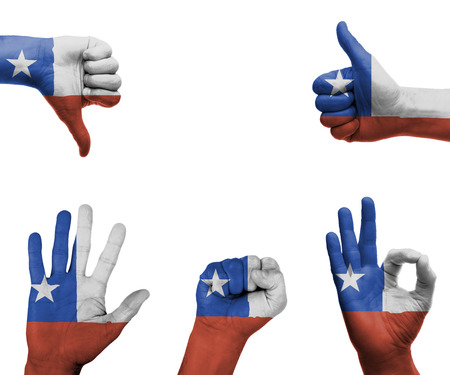 A set of hands with different gestures wrapped in the flag of Chile photo