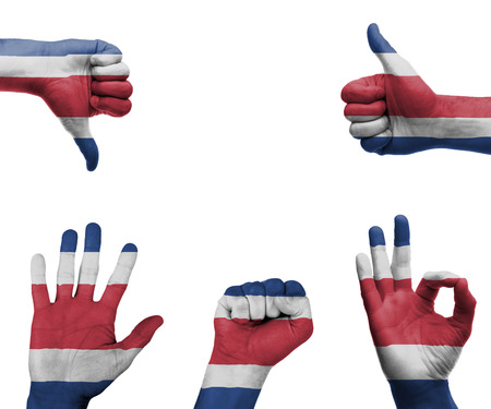 A set of hands with different gestures wrapped in the flag of Costa Rica photo