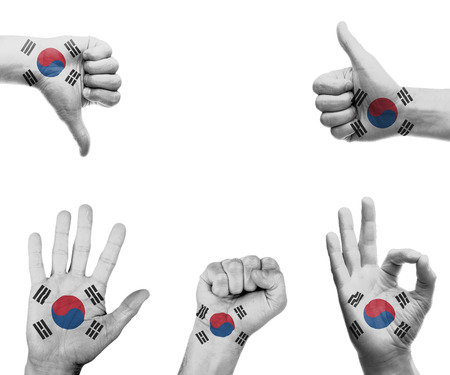 A set of hands with different gestures wrapped in the flag of South Korea photo