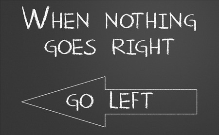 When nothing goes right go left written on a chalkboard photo