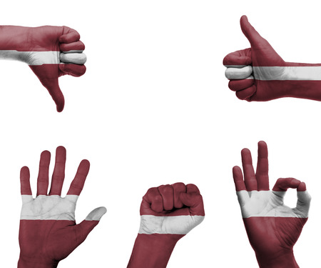A set of hands with different gestures wrapped in the flag of Latvia photo