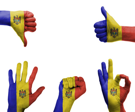 A set of hands with different gestures wrapped in the flag of Moldova photo
