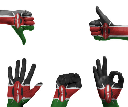 A set of hands with different gestures wrapped in the flag of Kenya photo
