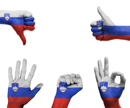 A set of hands with different gestures wrapped in the flag of Slovenia photo