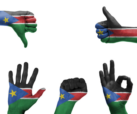 A set of hands with different gestures wrapped in the flag of South Sudan photo