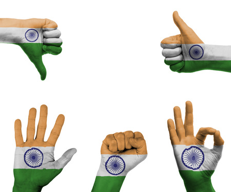 A set of hands with different gestures wrapped in the flag of India photo