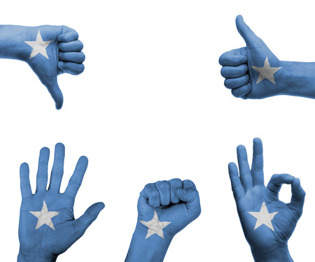 somalian: A set of hands with different gestures wrapped in the flag of Somalia