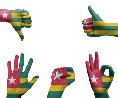 A set of hands with different gestures wrapped in the flag of Togo photo