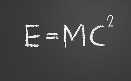 the theory of relativity: E=mc2. Theory of relativity written on a chalkboard Stock Photo