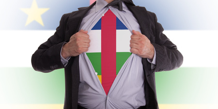 Business man rips open his shirt to show his Central African Republic flag t-shirt photo