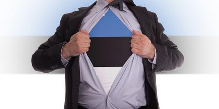 rips: Business man rips open his shirt to show his Estonia flag t-shirt Stock Photo