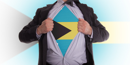 bahama: Business man rips open his shirt to show his Bahama flag t-shirt Stock Photo