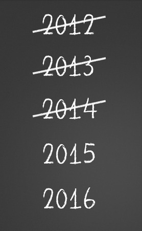 2012, 2013, 2014 crossed and new years 2015, 2016 on chalkboard photo