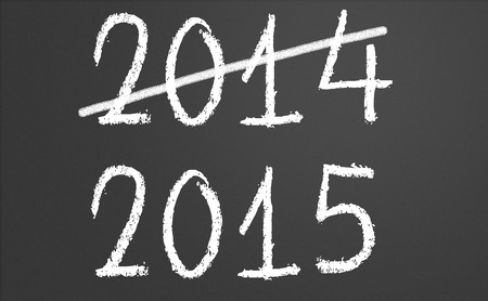 2014 crossed and new year 2015 written on chalkboard Stock Photo - 30323377